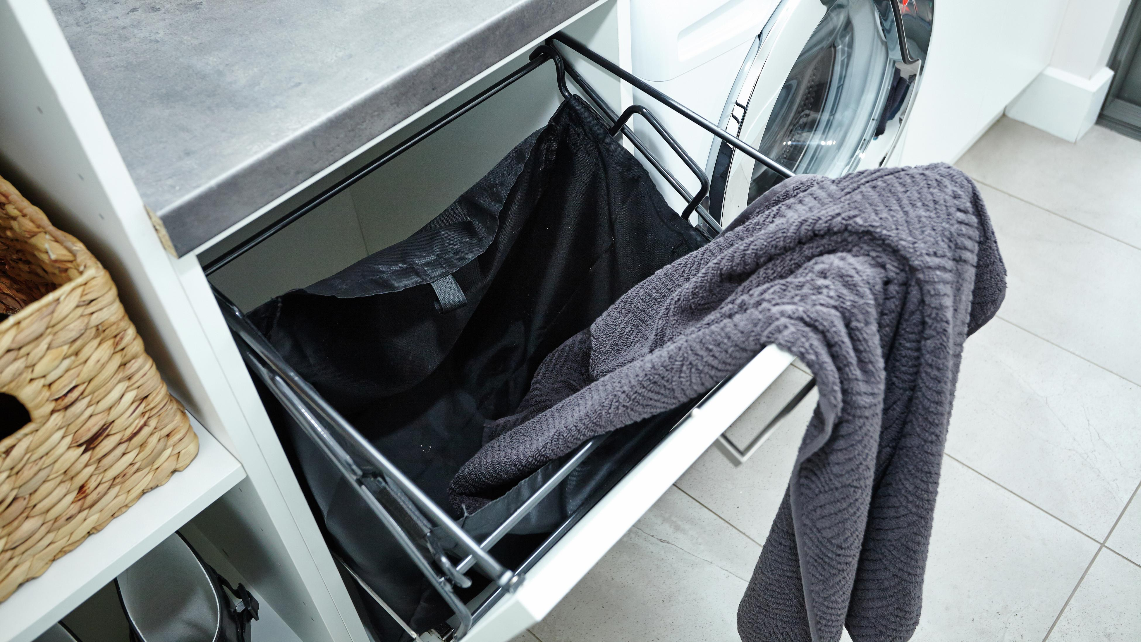 A 450mm laundry chute with a grey towel draped over it.