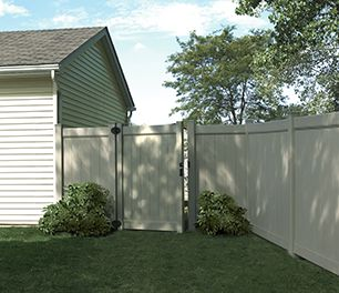 tall solid timber fencing around a backyard, with an open gate