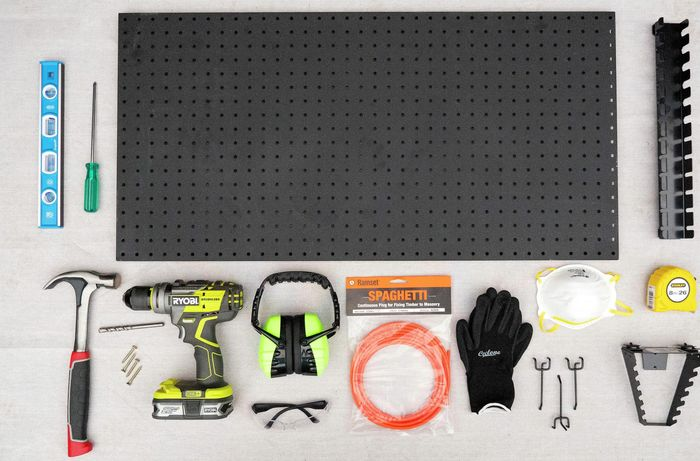 Pegboard, spirit level, safety equipment, screwdriver and various other tools.