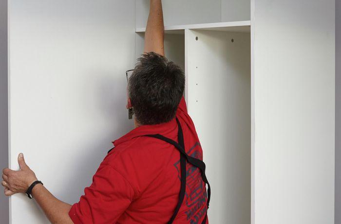 Person hanging door up.