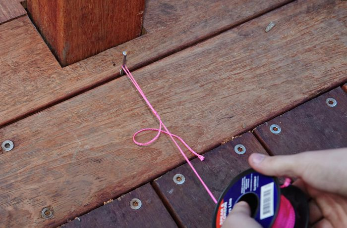 Person setting out string line.