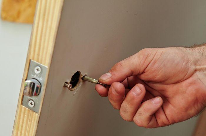Bolts being positioned in a door for a door handle