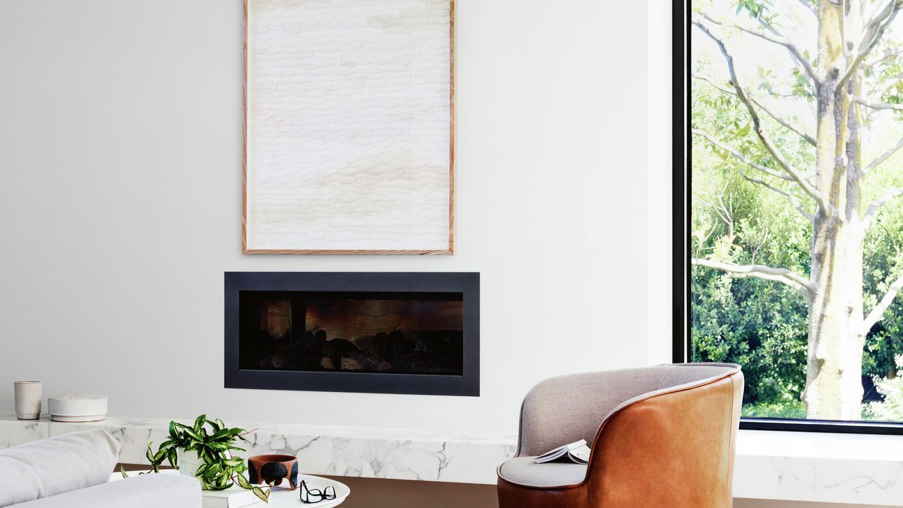 a white wall with a fireplace
