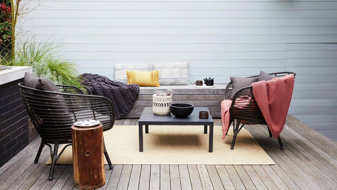 Outdoor deck with furniture.