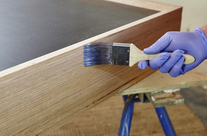 Varnish being applied to a dog bed
