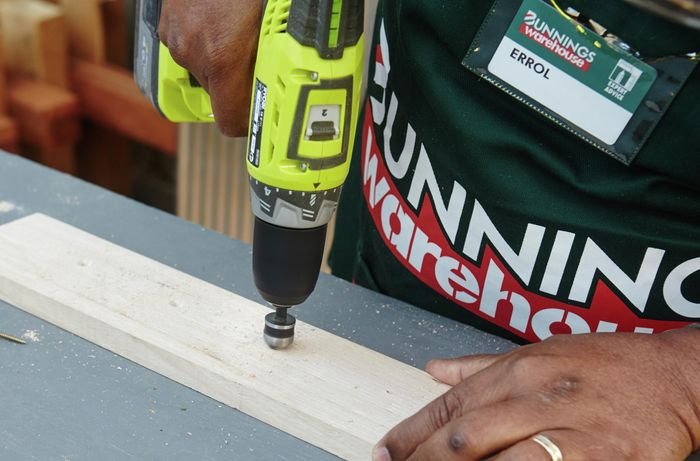 Person drilling into timber with countersink drill bit