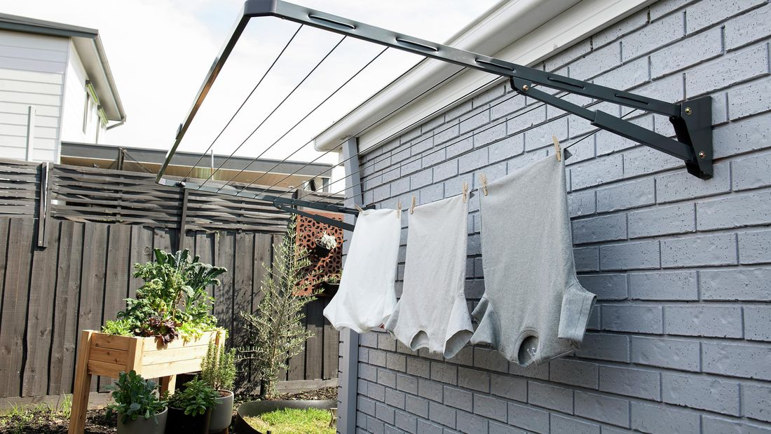 Outdoor clothesline with t-shirts hanging off it.