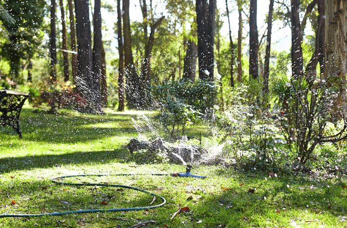 Ground sprinkler whizzing a lot of water around.