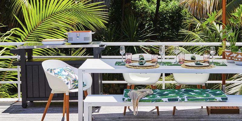 Outdoor living furniture and table setting.