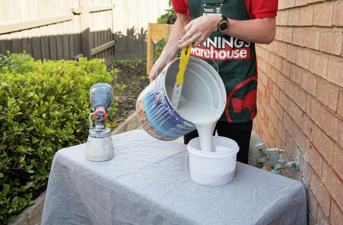 Person pouring paint.