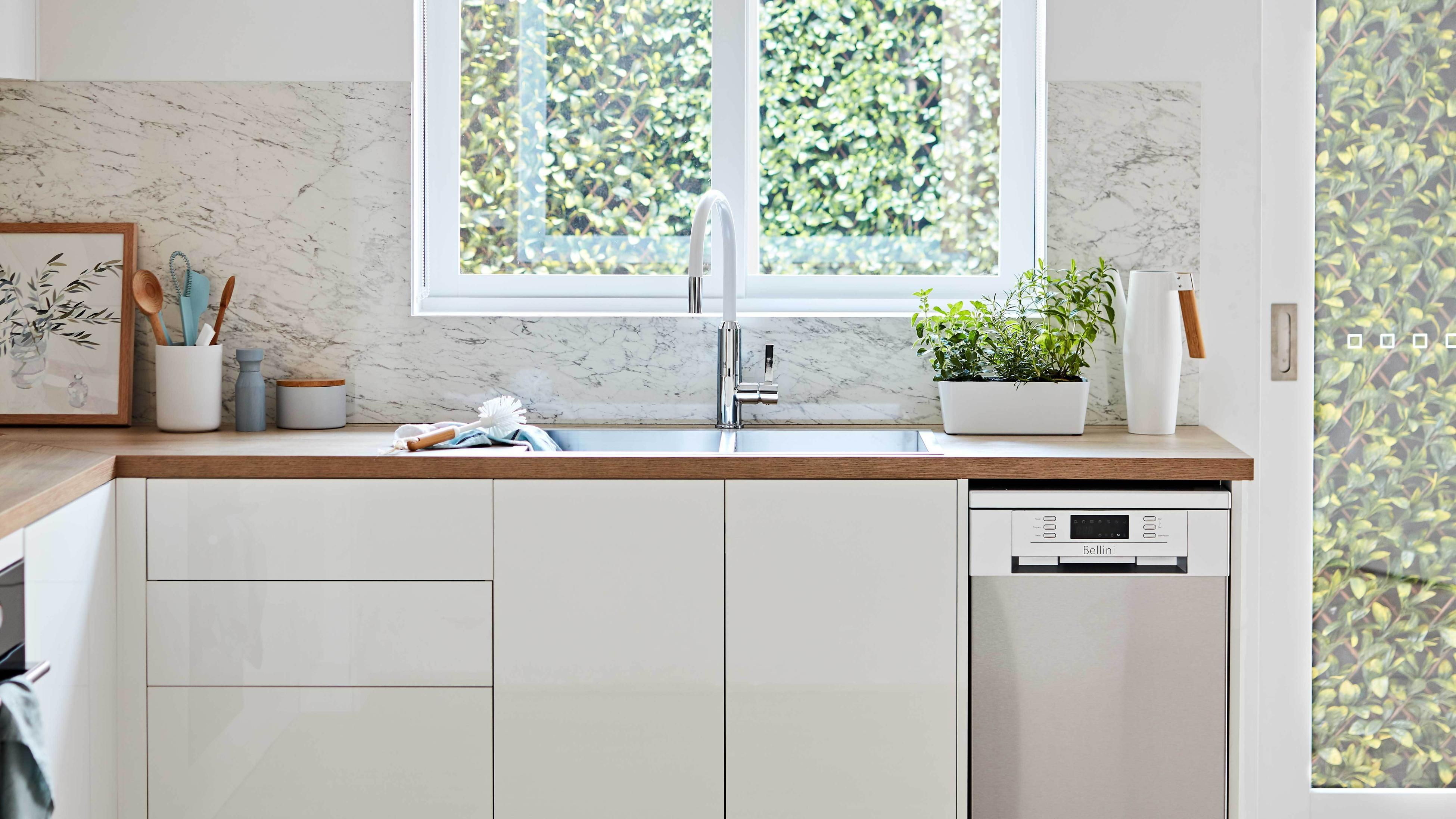 Scandi style kitchen with white cabinetry and timber finishes.