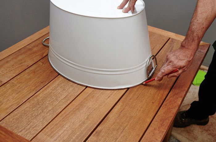 DIY Step Image - D.I.Y. outdoor table with built-in drinks cooler . Blob storage upload.