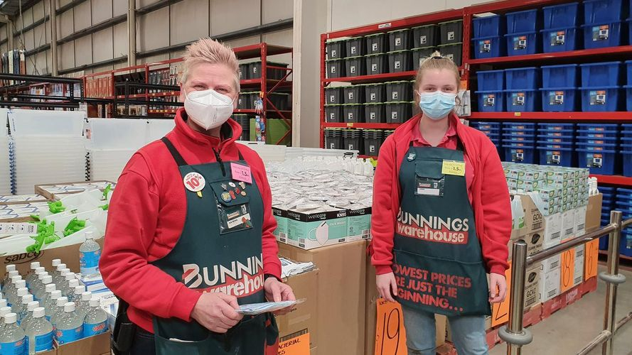 2 Bunnings TM's in a store wearing masks