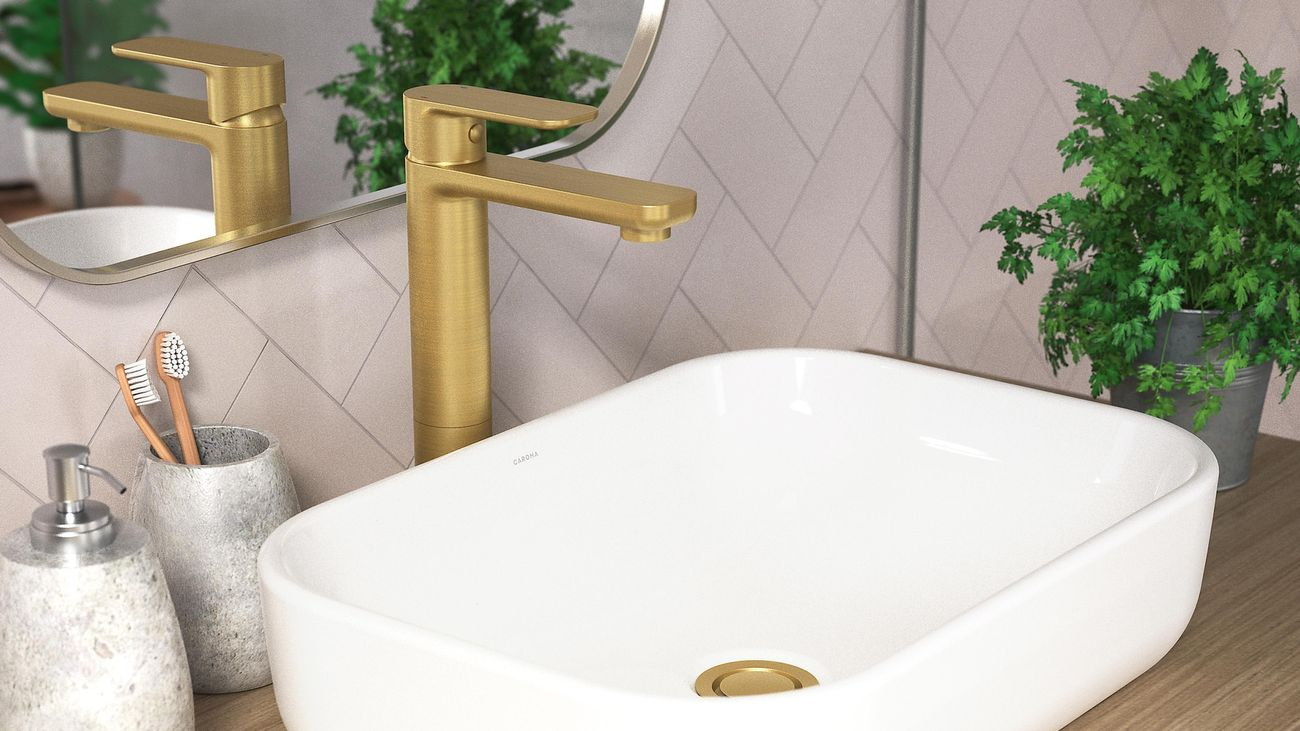 Bathroom sink with gold tapware