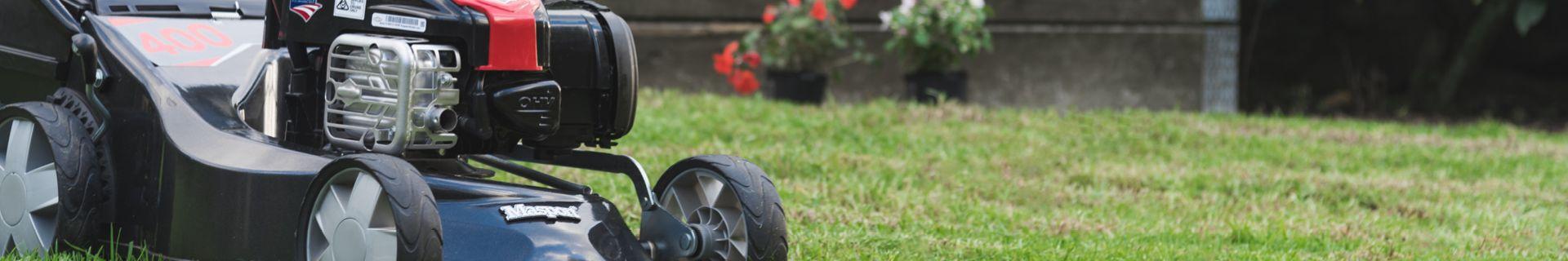 Lawn mower mowing lawn.