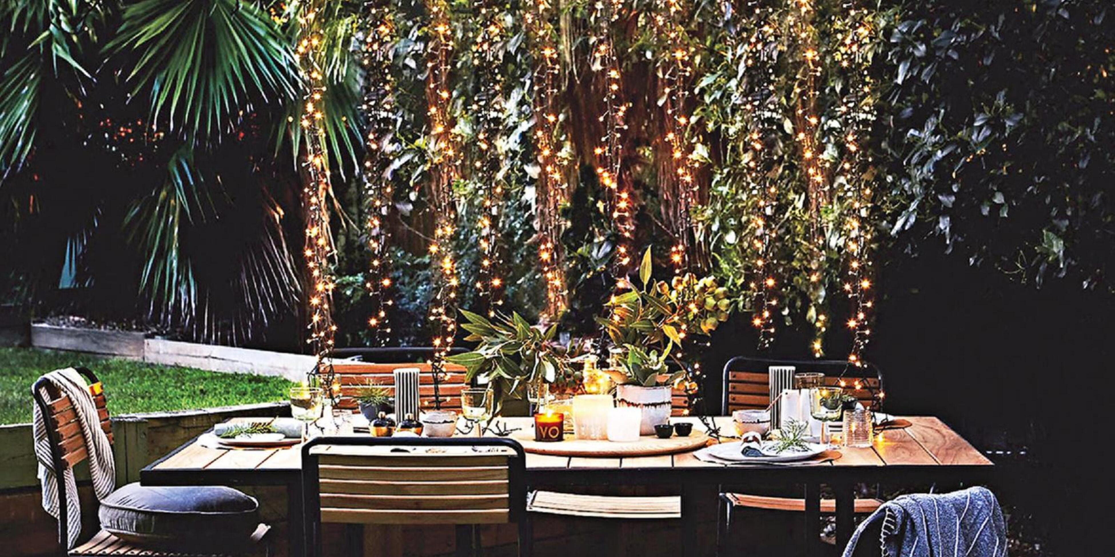 Outdoor dining table with hanging fairy lights
