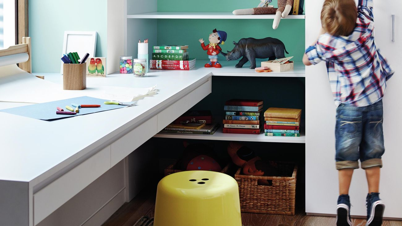Kids desk surrounded by toys and children's books