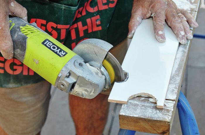 DIY Step Image - How to lay a herringbone tile pattern . Blob storage upload.