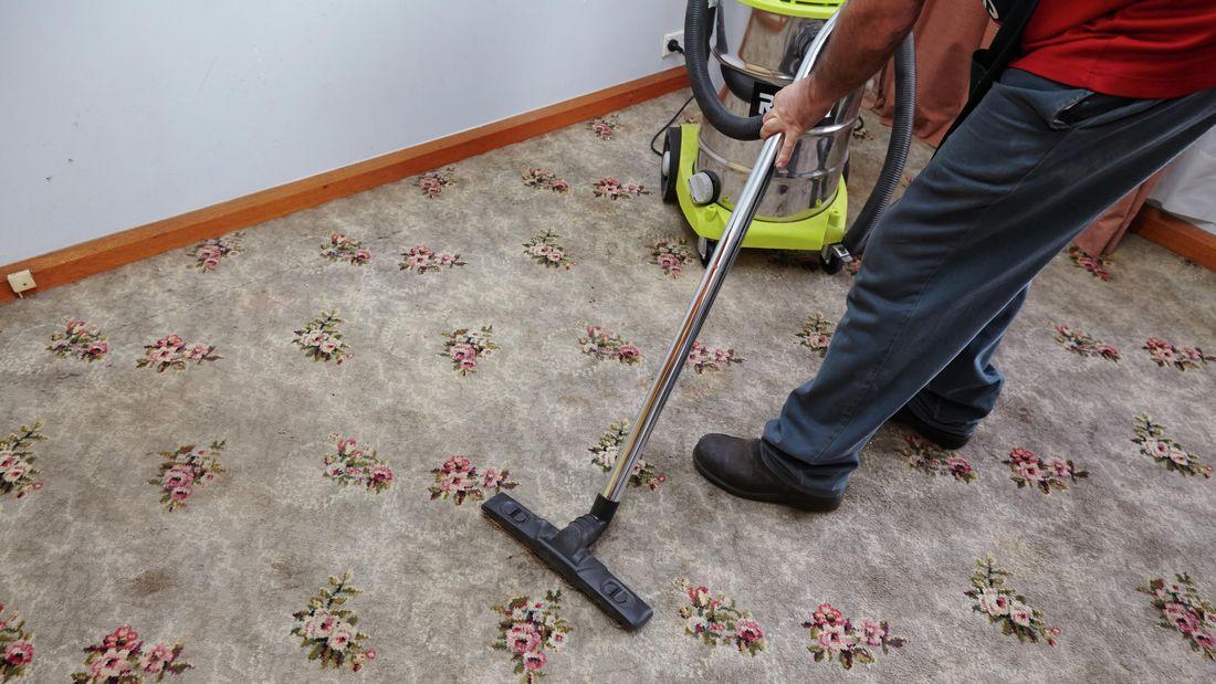 Bunnings team member vacuuming carpet
