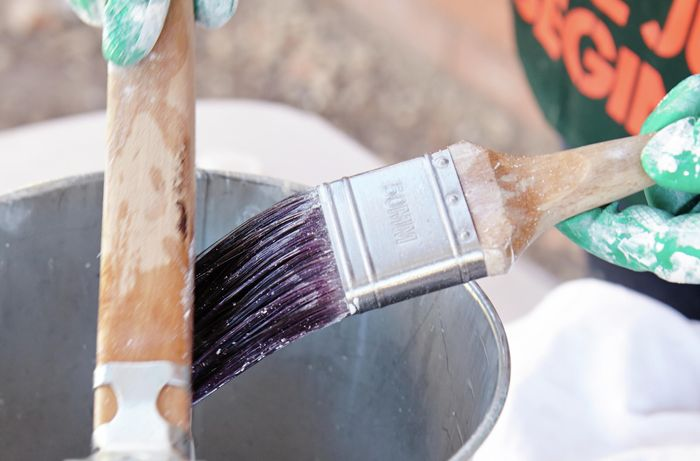 Cleaning dried paint off your brush with a paintbrush restorer