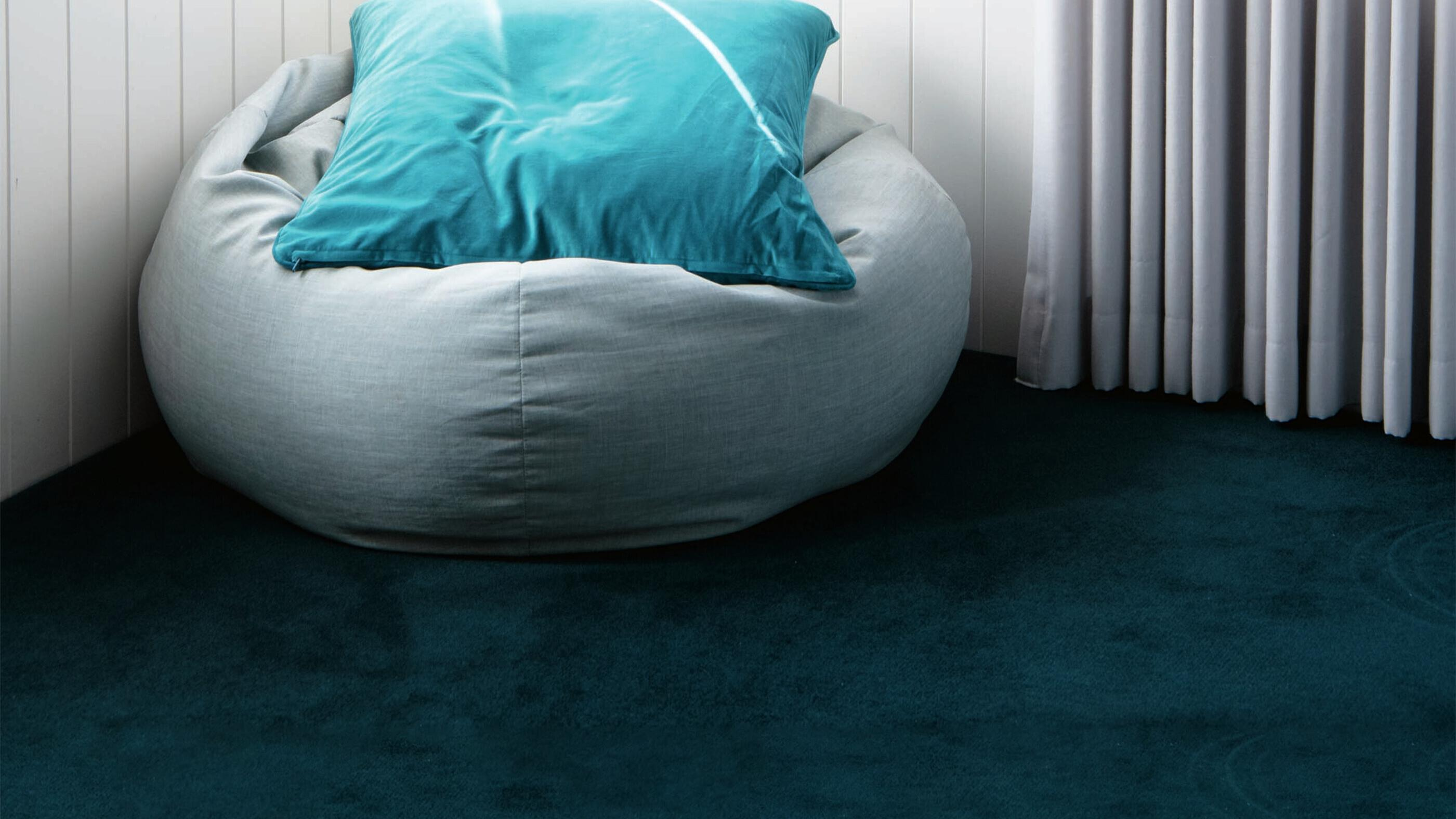 Carpet with grey bean bag on it