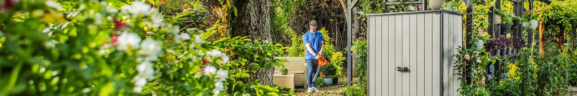 Man using leaf blower.