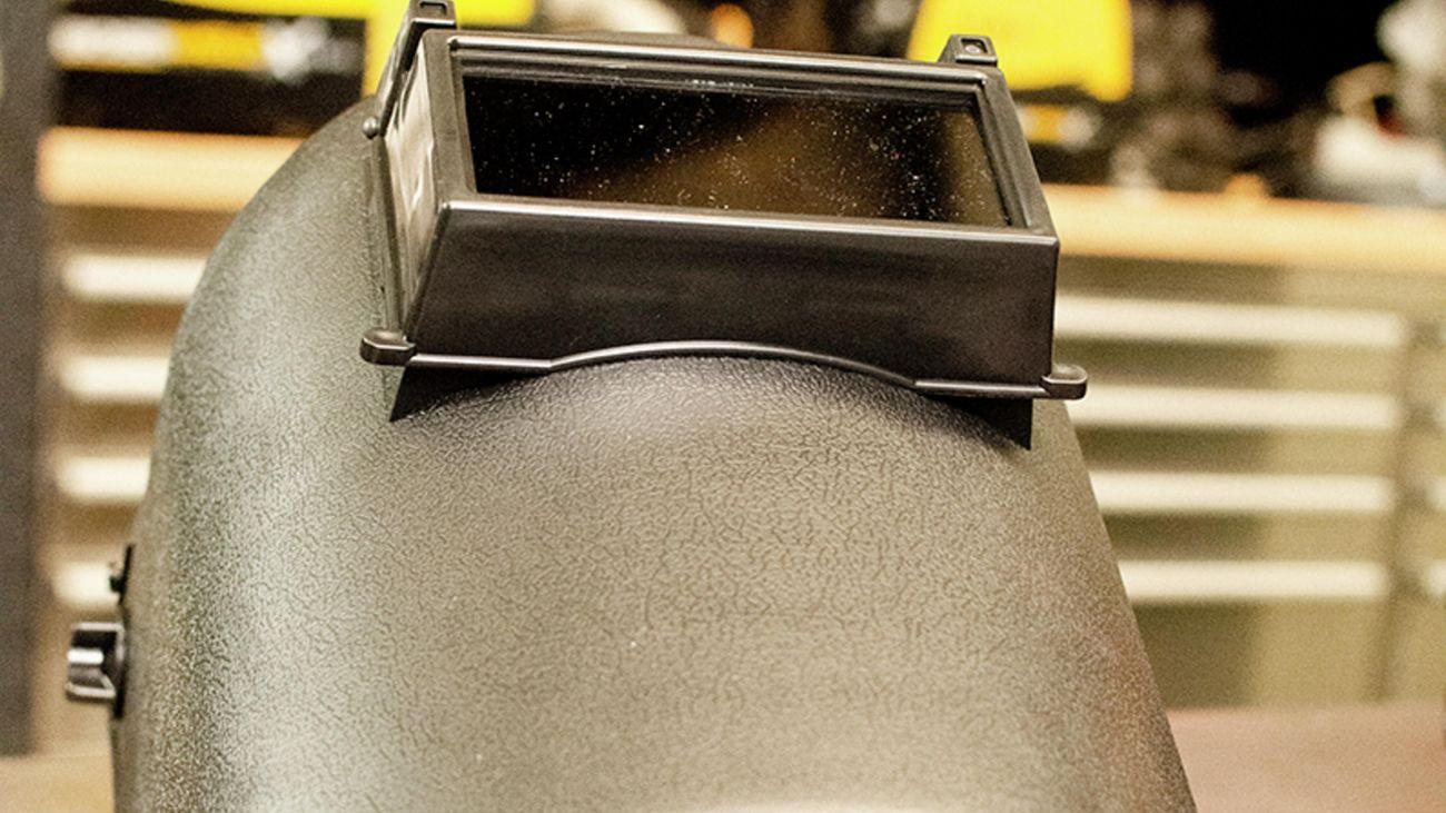 Close up shot of a grey welding helmet.