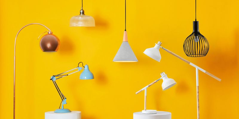 A series of pendant lights and lamps lined up.