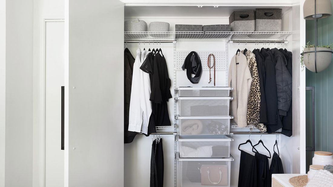 A tidy wardrobe with hanging space, wire drawers and shelving
