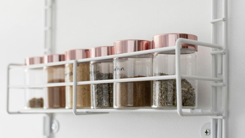 A series of cannisters in a kitchen pantry
