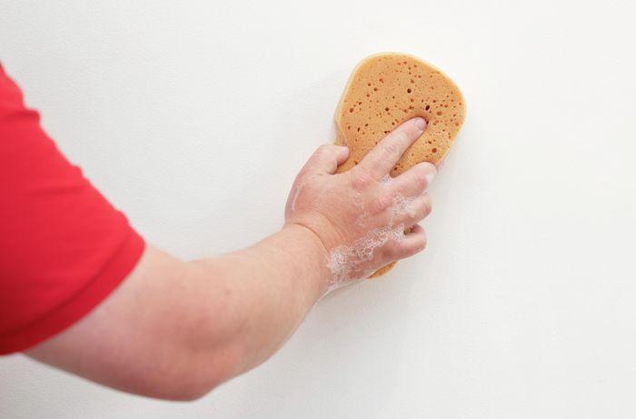 Washing the wall with sugar soap