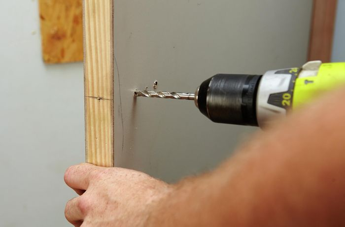 Drilling into a door from the other side to make way for a door handle