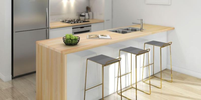 White colour scheme kitchen with timber benchtops.