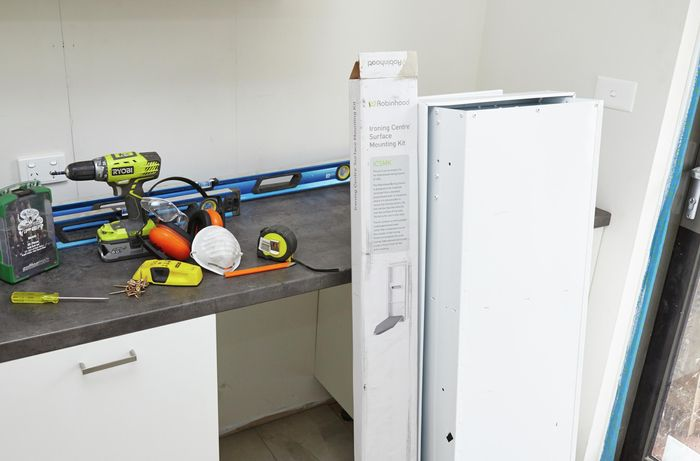 The tools and materials you need to install an ironing centre.