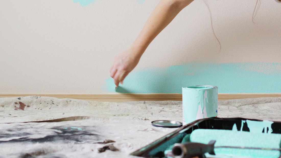 Painting a wall with blue paint