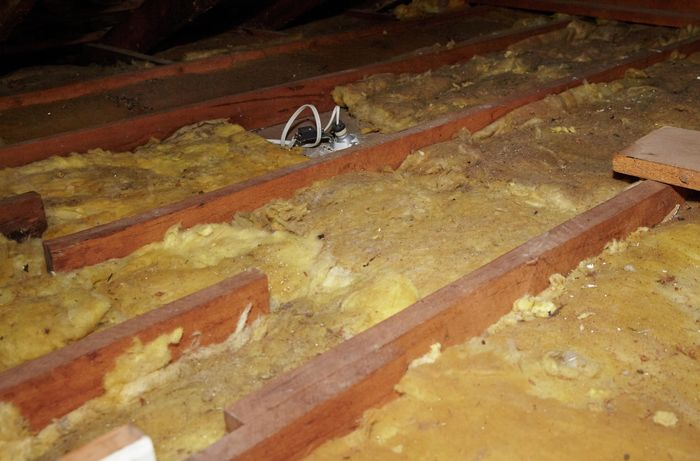 A roof space with a single layer of insulation batts between the rafters