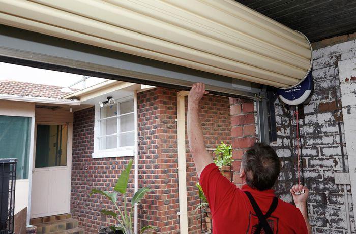 DIY Step Image - How to install a garage door opener . Blob storage upload.