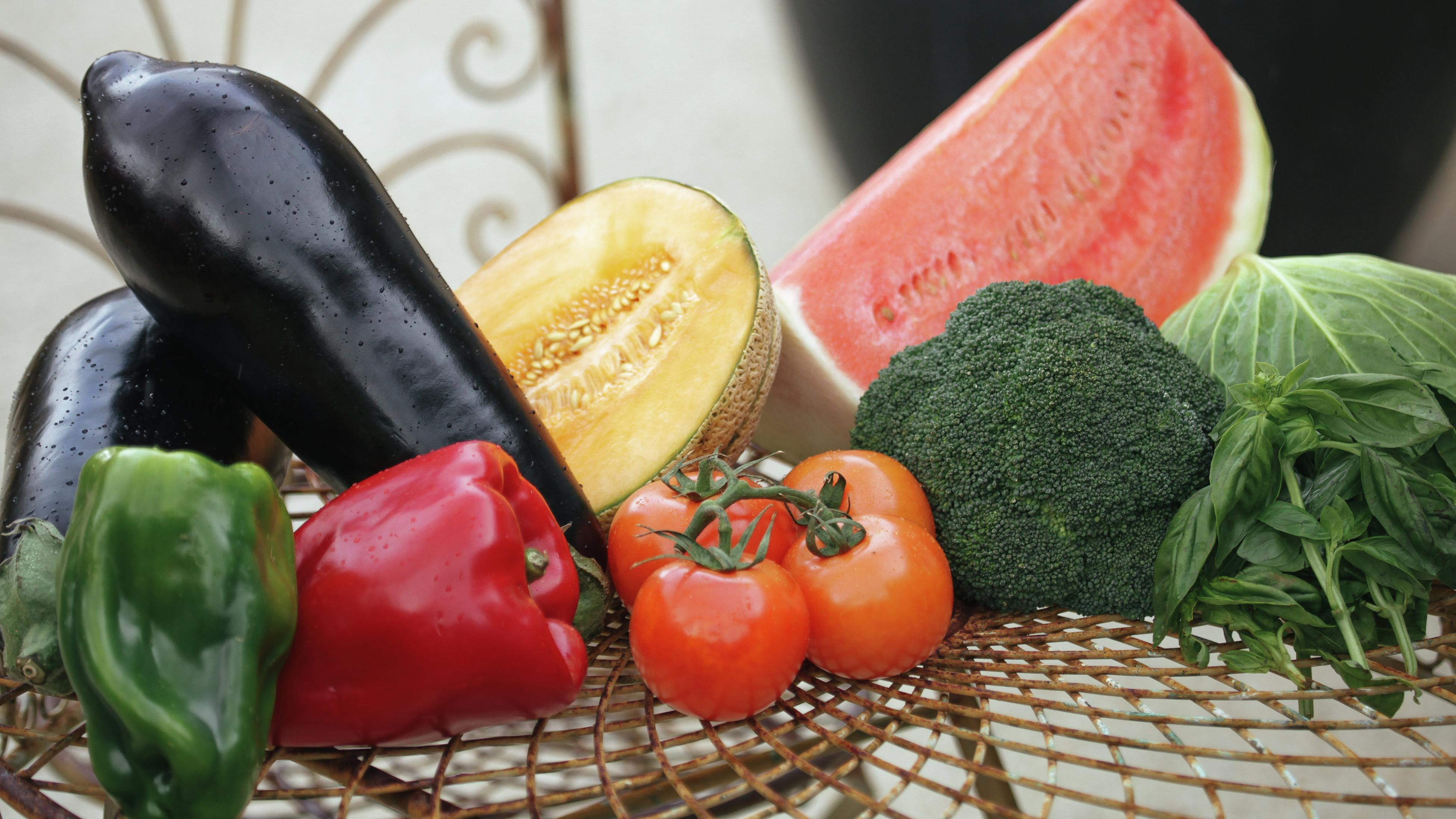 Harvested fruit and vegetables, including tomatoes, capsicum, broccoli, basil, watermelon and fresh rockmelon.