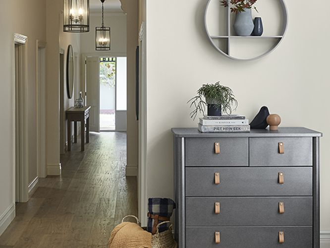 Hallway with timber floorboards, bench and chest of drawers