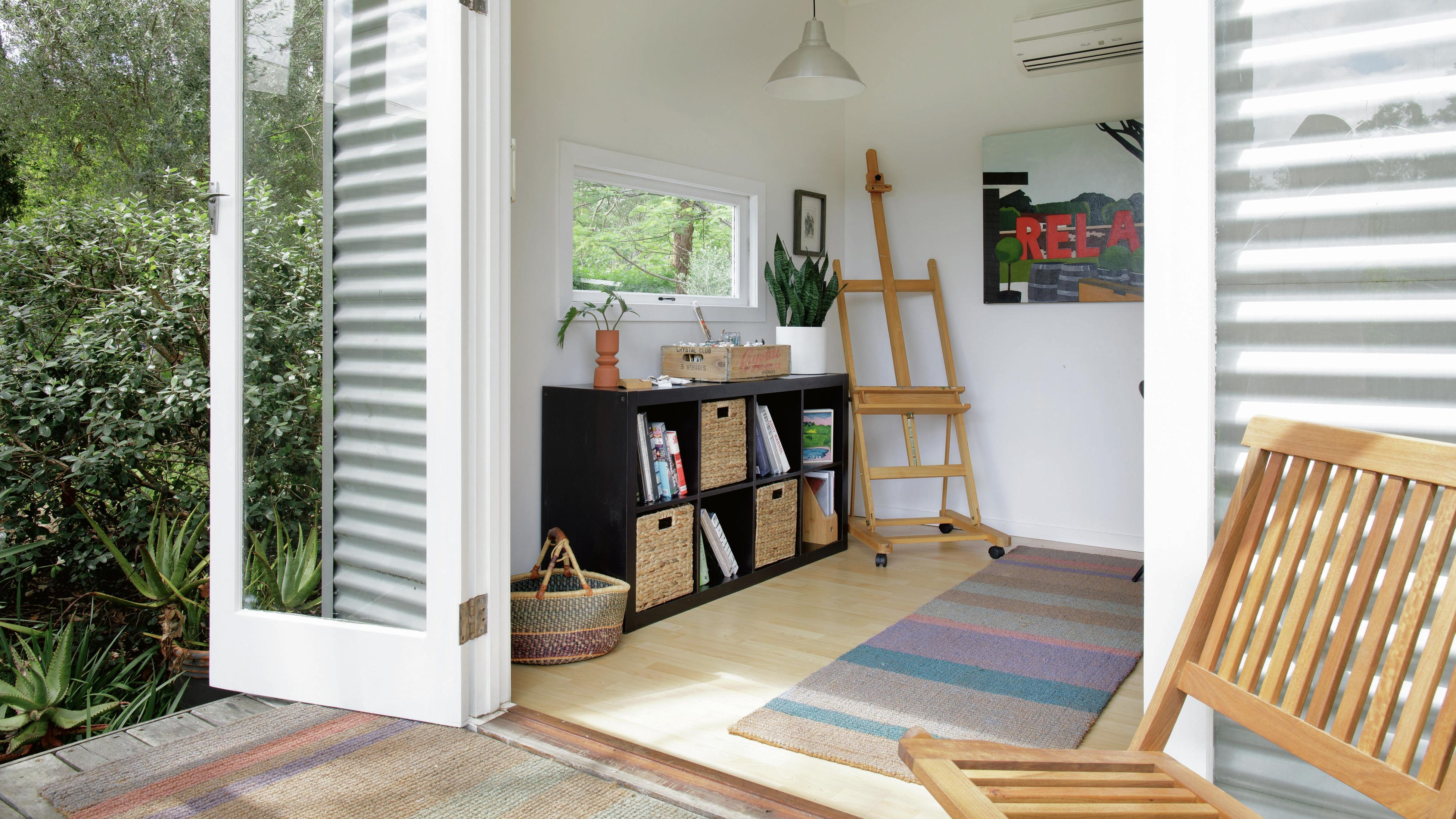 View from a deck through French doors into a home office