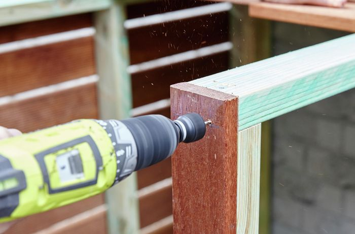 Person drilling timber together.