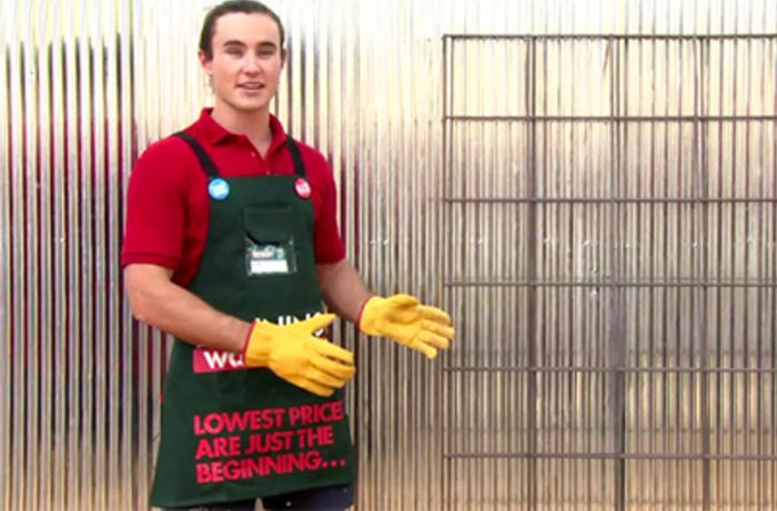 A Bunnings team member with two metal frames