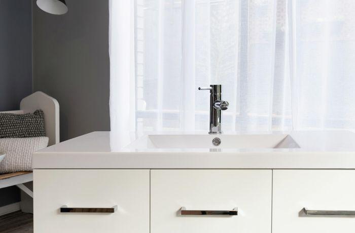 Bathroom sink installed on top of a vanity