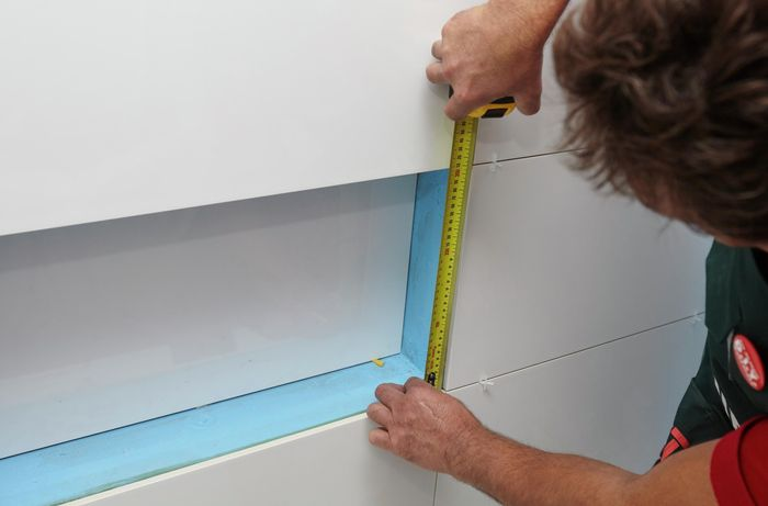 DIY Step Image - How to fit and install tile trim . Blob storage upload.