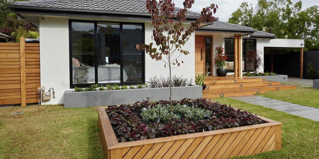 Front garden of a house with garden path and planter box.