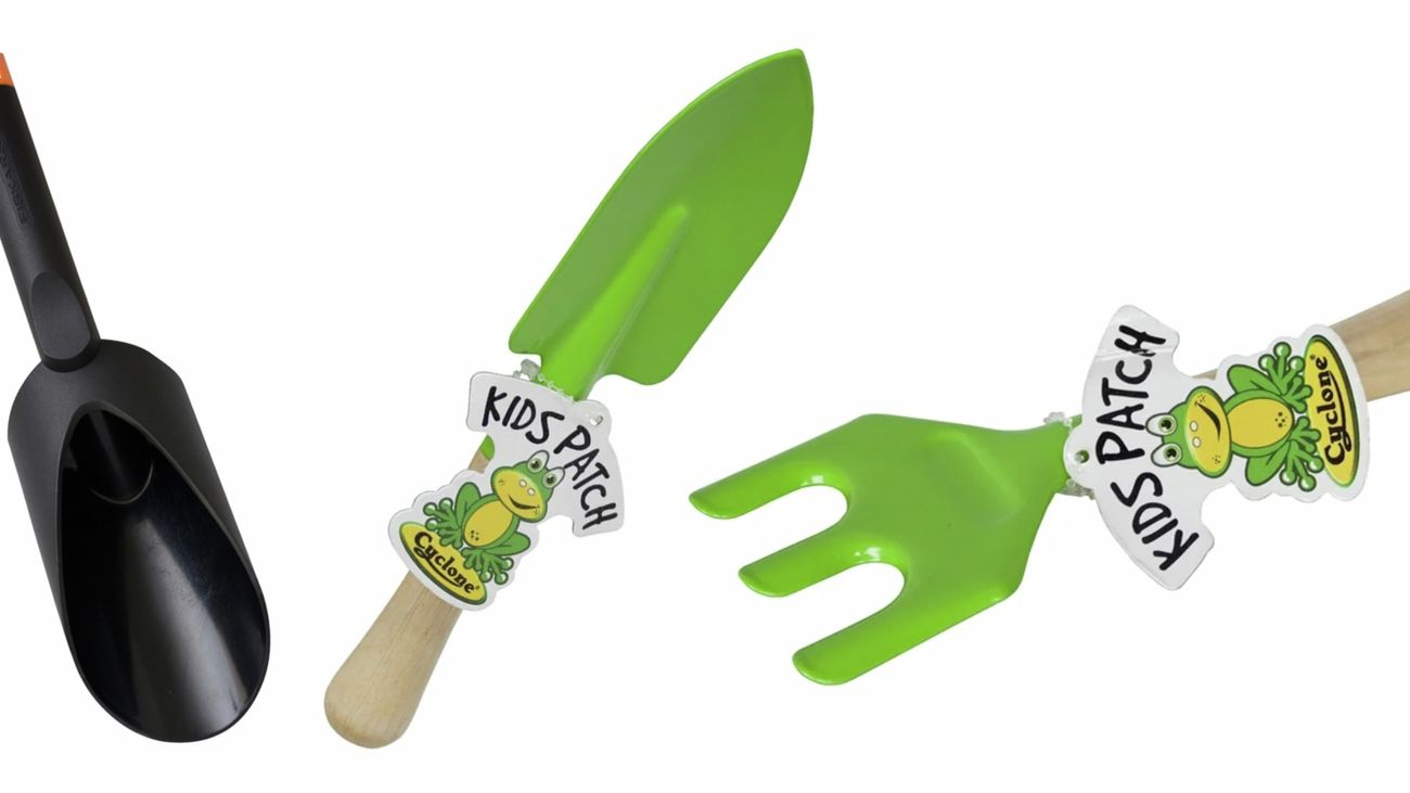 kids garden tools on a white background
