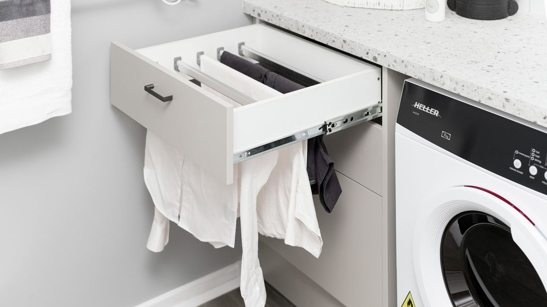 Laundry with pull-out drying drawer.