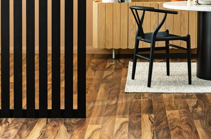 A black painted slatted room divider in a living area