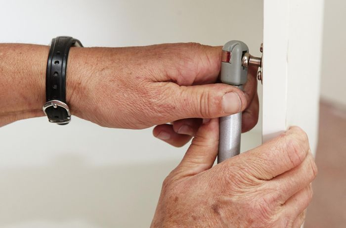 DIY Step Image - How to install door hinges and gas struts . Blob storage upload.