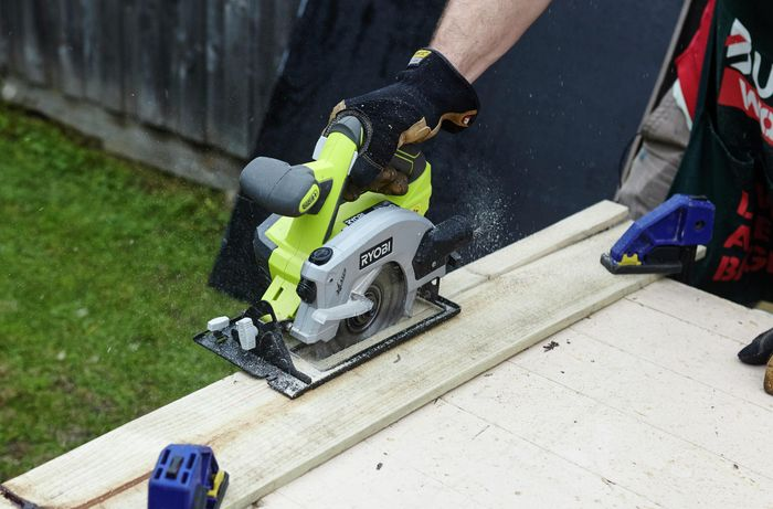 A circular saw being used to cut a plank of timber to size